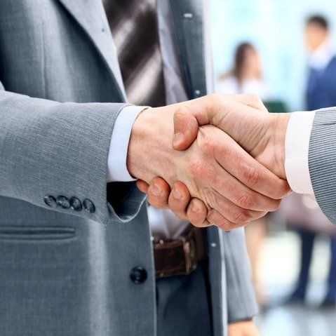 Handshake in front of business brokers in Delta