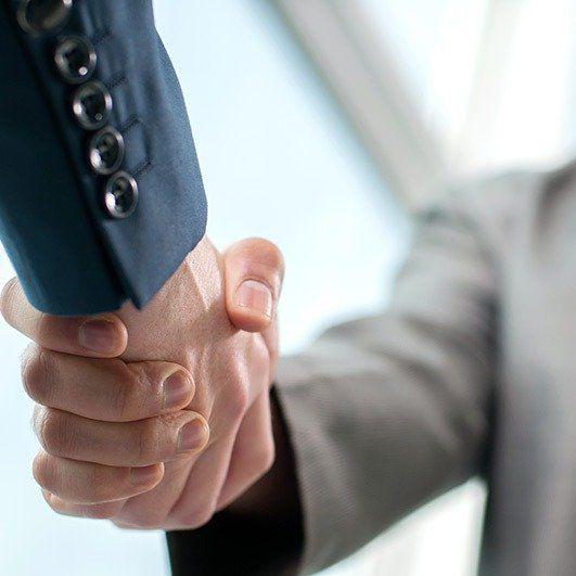 business shake hand to make an agreement