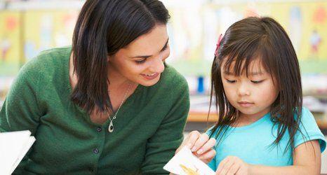 teacher teaching her student
