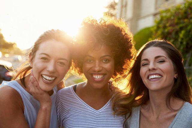 3 smiling ladies
