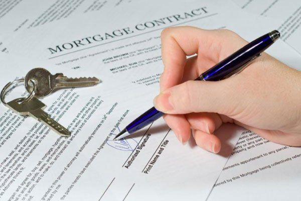 la consegna del contratto di mutuo per una casa nuova e chiavi