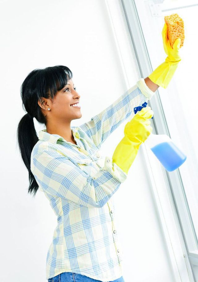 A residential cleaning expert is cleaning windows in Anchorage, AK