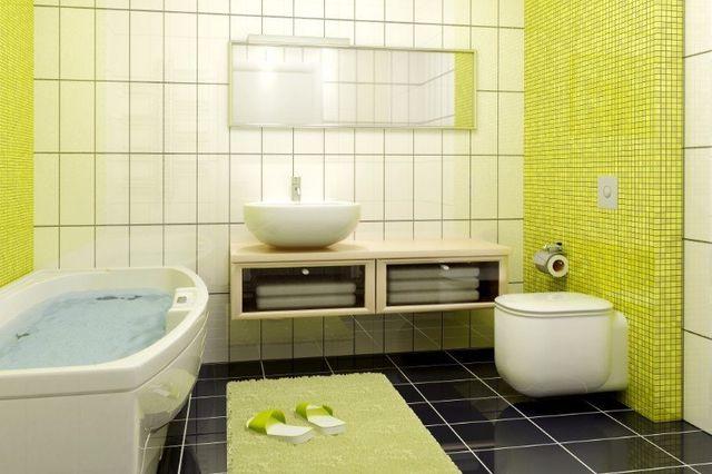 Bagno verde e bianco, vasca,lavandino e water di progettazione