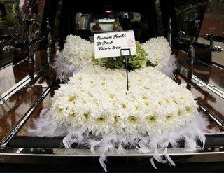 Cuscino funebre a forma di angelo