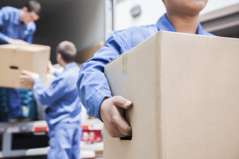 Residential Moving — Man Carrying Box in Lorton, VA
