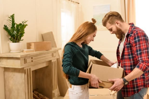 Moving Service — Couple Opening A box in Lorton, VA