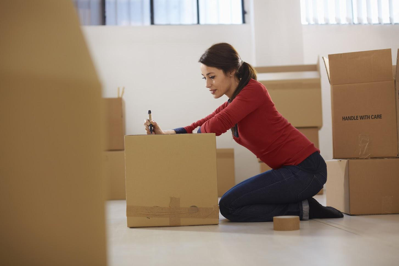 Woman Packing Boxes — Fairfax, VA — Fairfax Transfer and Storage Inc.