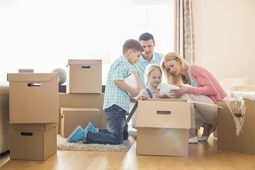 Family with Moving Boxes — Local Moving Company in Lorton, VA