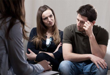 Image of two women and a man discussing a serious issues