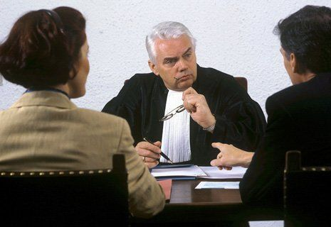 Couple discussing with a lawyer