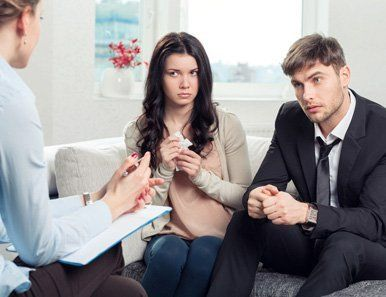 Image of three people engrossed in a conversation