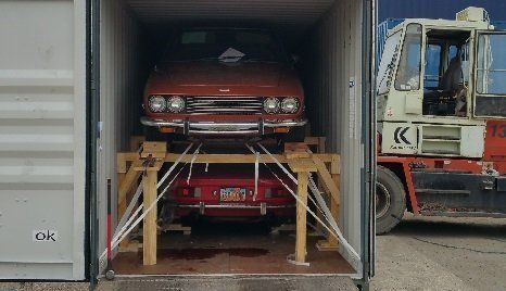 car loaded in container