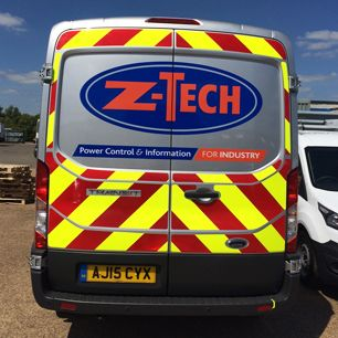 Vehicle graphics behind a vehicle