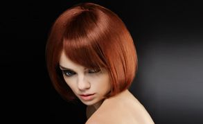 A lady with red hair in a glossy bob style