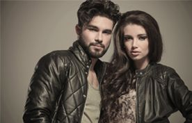A young dark-haired couple in leather jackets