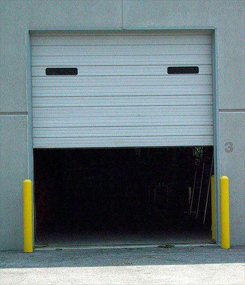 a door during maintenance for commercial garage doors in mo