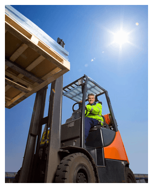 A man in a forklift truck lifting some wooden pallets