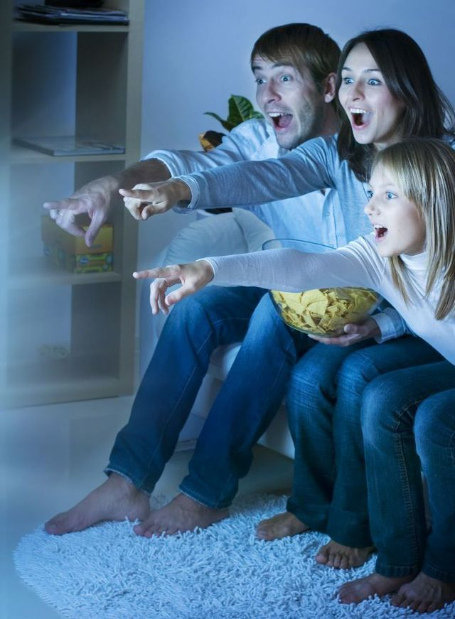Family enjoy watching TV after digital TV installation in Auckland
