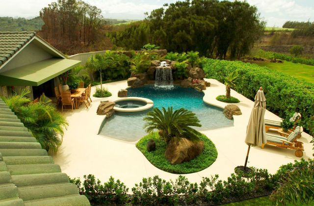 backyard pool with waterfall and hot tub in Maui