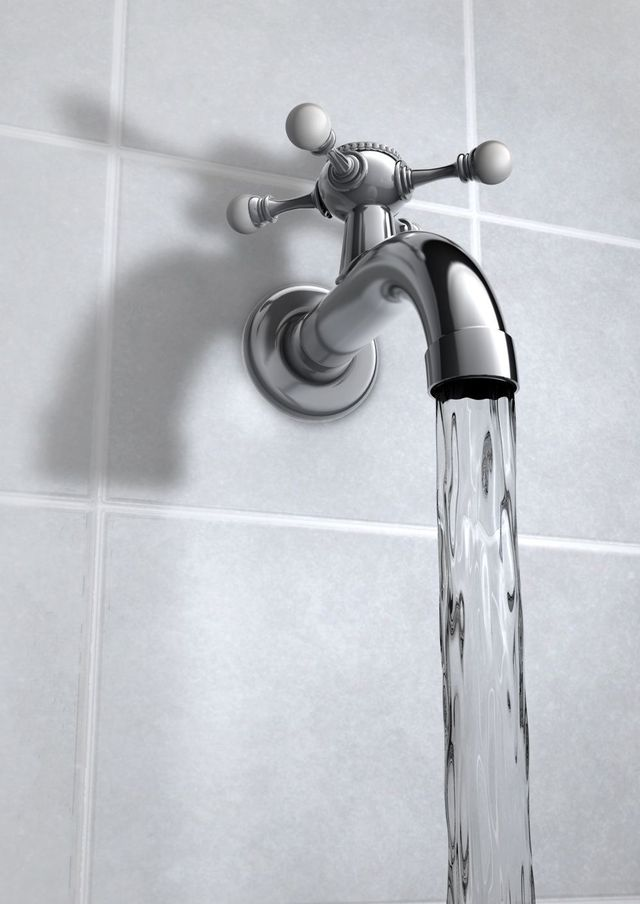 A tap running again after plumbing work on the North Shore