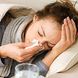Woman sick in bed with a cold in Long Island