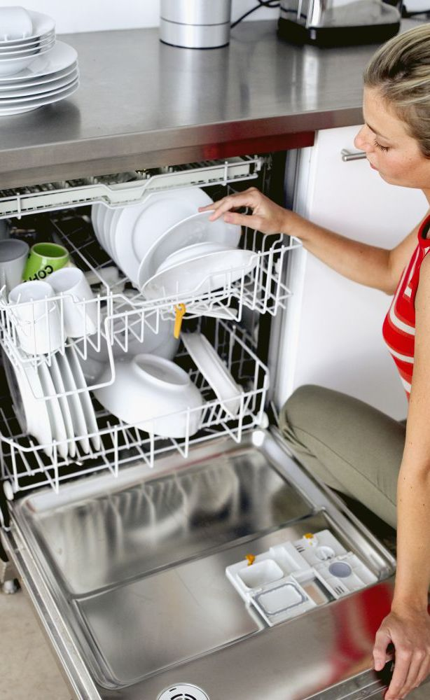woman loading dish washer