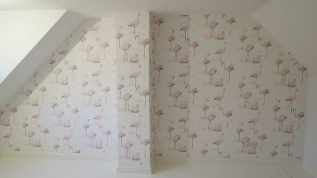 A wallpapered bedroom feature wall