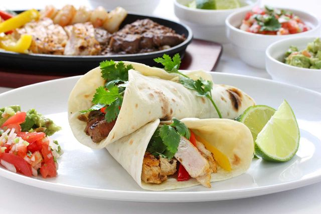 Beef chicken and shrimp fajitas