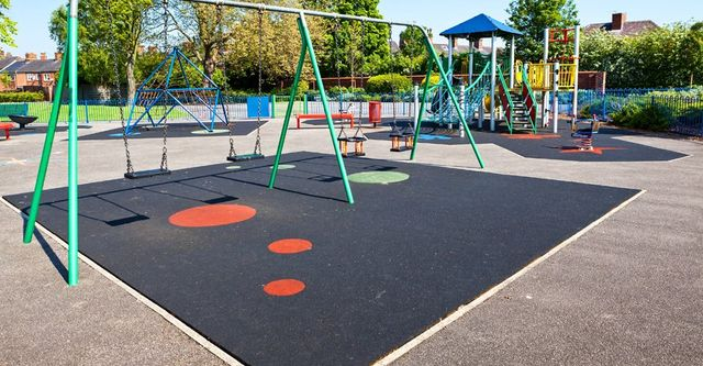rubber ground covering under childrens' swings