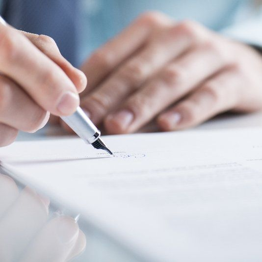 Hand filling in a legal document