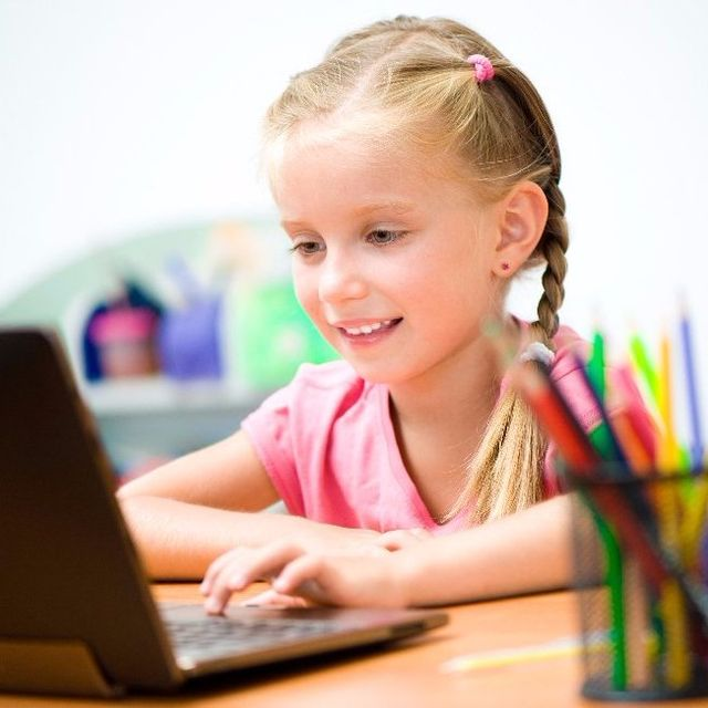 Girl in CyberKids Computer Class