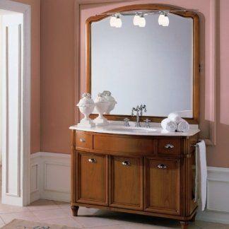 un mobile da lavabo in legno con uno specchio al muro