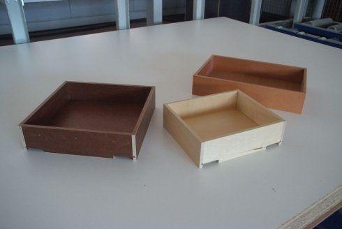 tre cassetti di legno