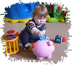 Baby and piggy bank in a childcare