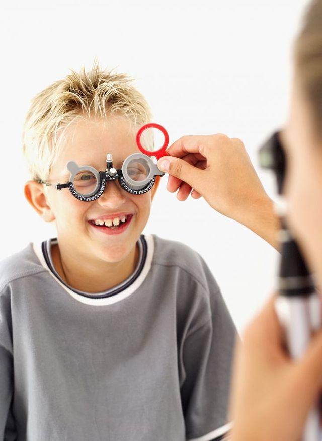 Optometrists performing an exam on a child in Bullhead City, AZ