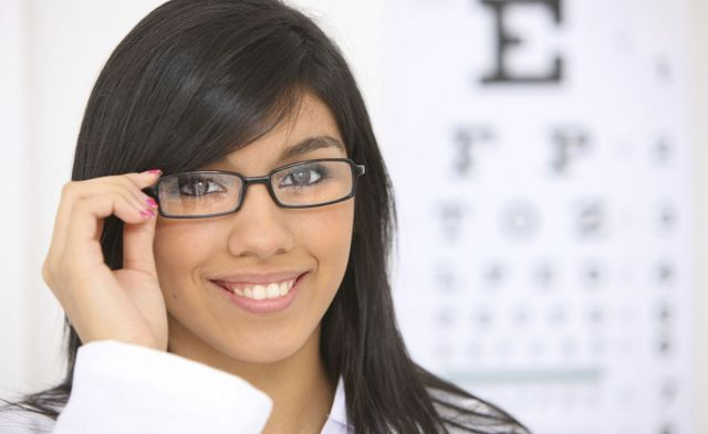A stylish woman is wearing glasses in our eye clinic in Bullhead City, AZ