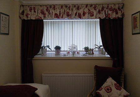 The treatment room with the window blinds drawn