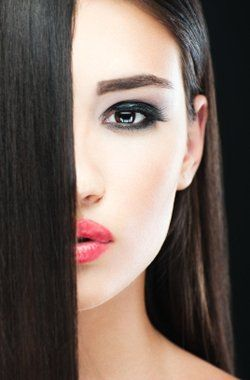 Young female posing with straight brown hair and make up