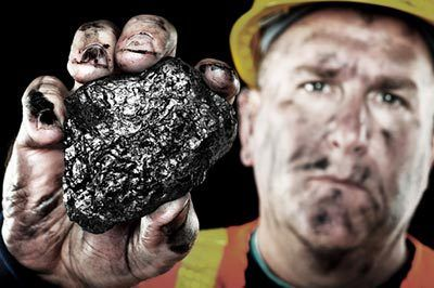 Coal miner holding a piece of coal in Princeton