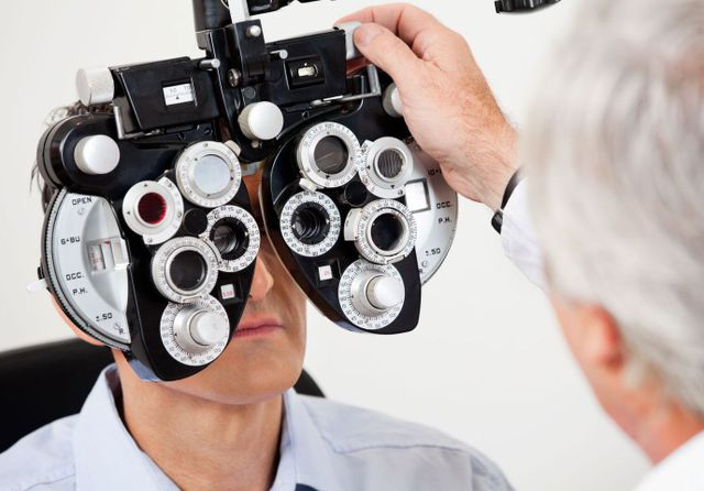 Elderly man is getting his eyes tested by an eye doctor in High Point, NC