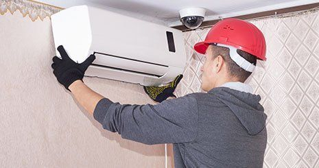 Technican repairs the air conditioner