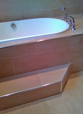 Tiling services, tilers, wall tiles, floor tiles, hardwood florring, joinery services - laminate flooring- tiling and slating - carpentry services - Morecambe - Brian P Lynch Professional Tiler - tiled wall and floor and bathtub basin