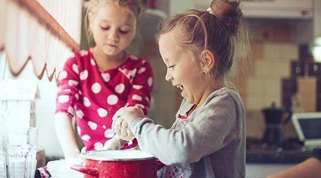 Two little girls baking