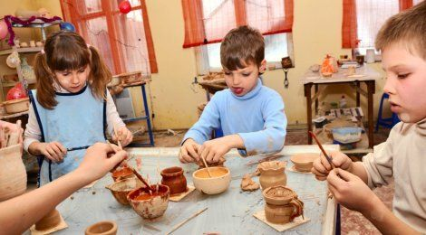 Children around a pottery-making table