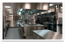 Commercial kitchen with stainless steel worktops