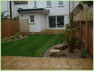 a back garden with wooden decking