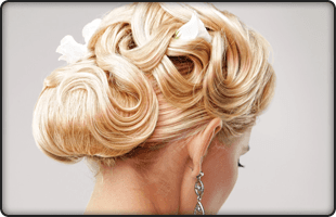 Lady with blonde hair in wedding hair style
