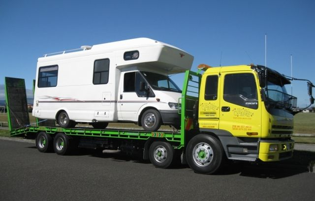 Campervan being towed for vehicle salvage in Palmerston North