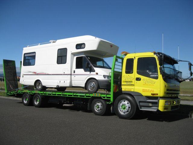 Caravan on tow truck