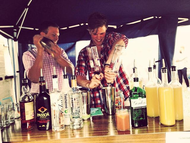 two bartenders mixing drinks
